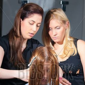 Teacher helps student learn to style hair
