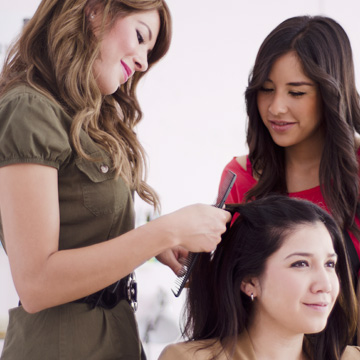 Students learn to style hair