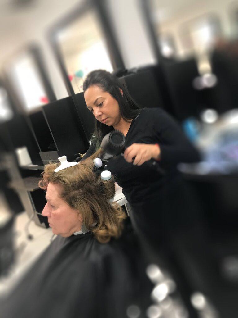 Rachel Islas doing hair