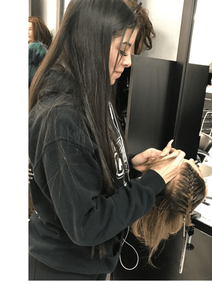 Andrea Loria, cosmetology student working on a client.