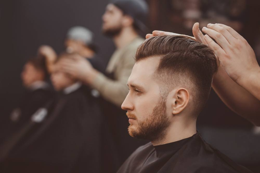 barber styling man's hair