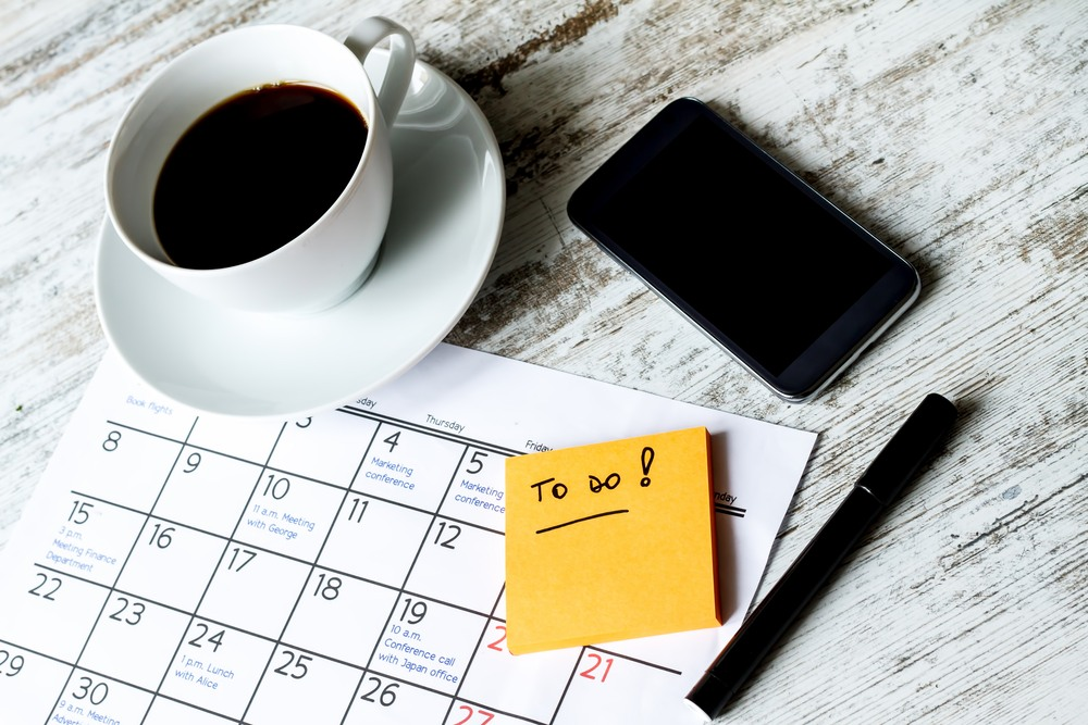 to do list and calendar with coffee cup and phone