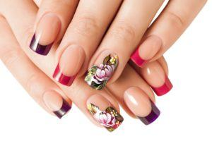 nails with tips painted purple, red, and floral patterns